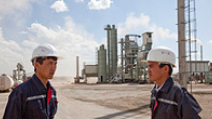 Two workers at an oil refinery in Kazakhstan. - Photo: Shutterstock