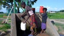 Children fetching water from a hand pump in rural Zambia. - Photo: africa924/Shutterstock